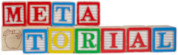 Learning letter blocks spelling out Metatorial - two rows